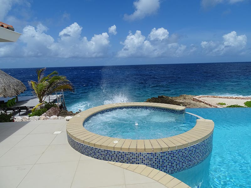 Relax in your Jacuzzi at the ocean front villa Rental Curacao -