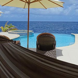 View overlook the infinity pool and the Caribbean Sea - Vacation Rental Curacao